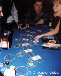 A croupier dealing cards